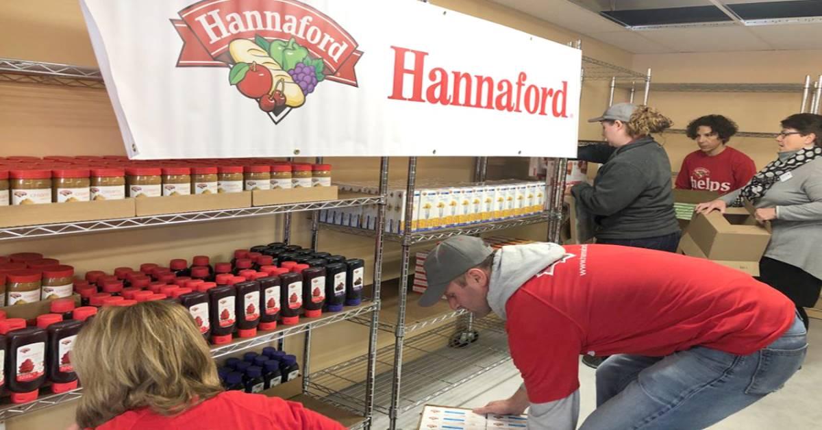 Volunteers stocking food pantry shelves