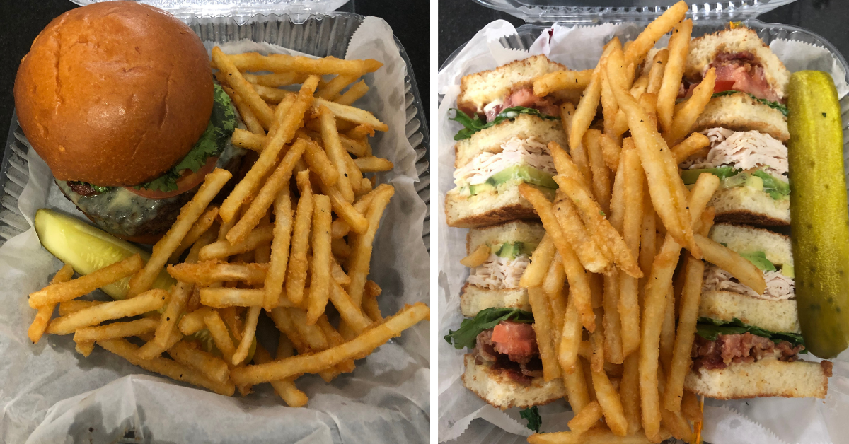 A burger and fries on the left and a turkey club sandwich with fries and a pickle on the right.