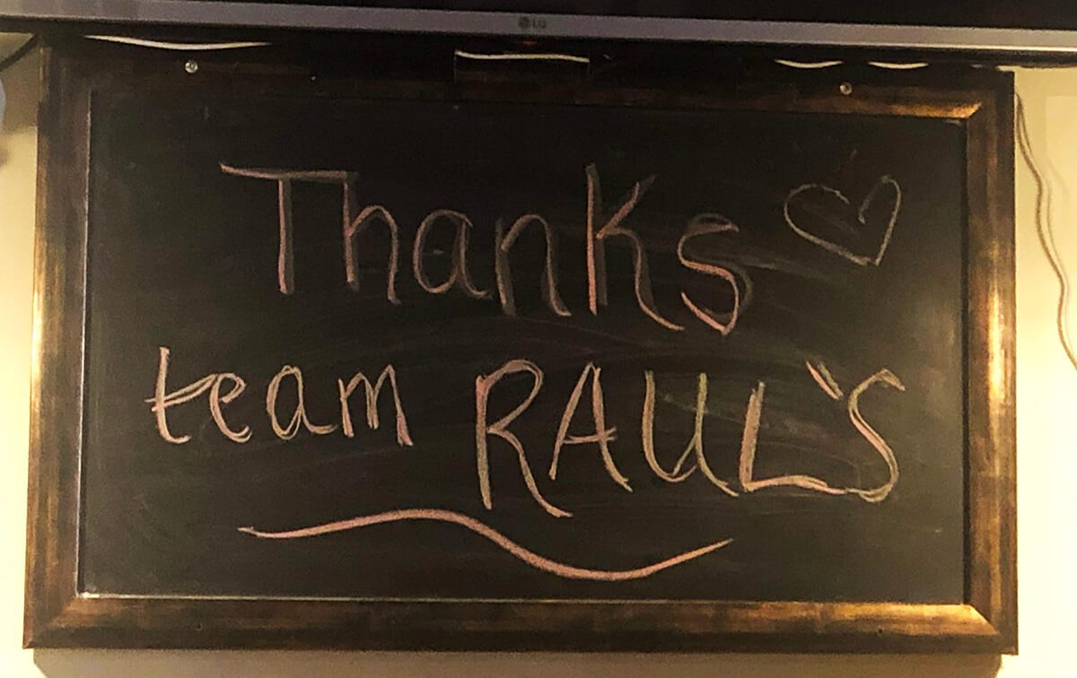 A chalkboard says Thanks Team Raul's