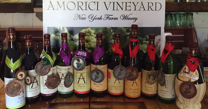 Amorici Vineyard wines lined up in front of a sign