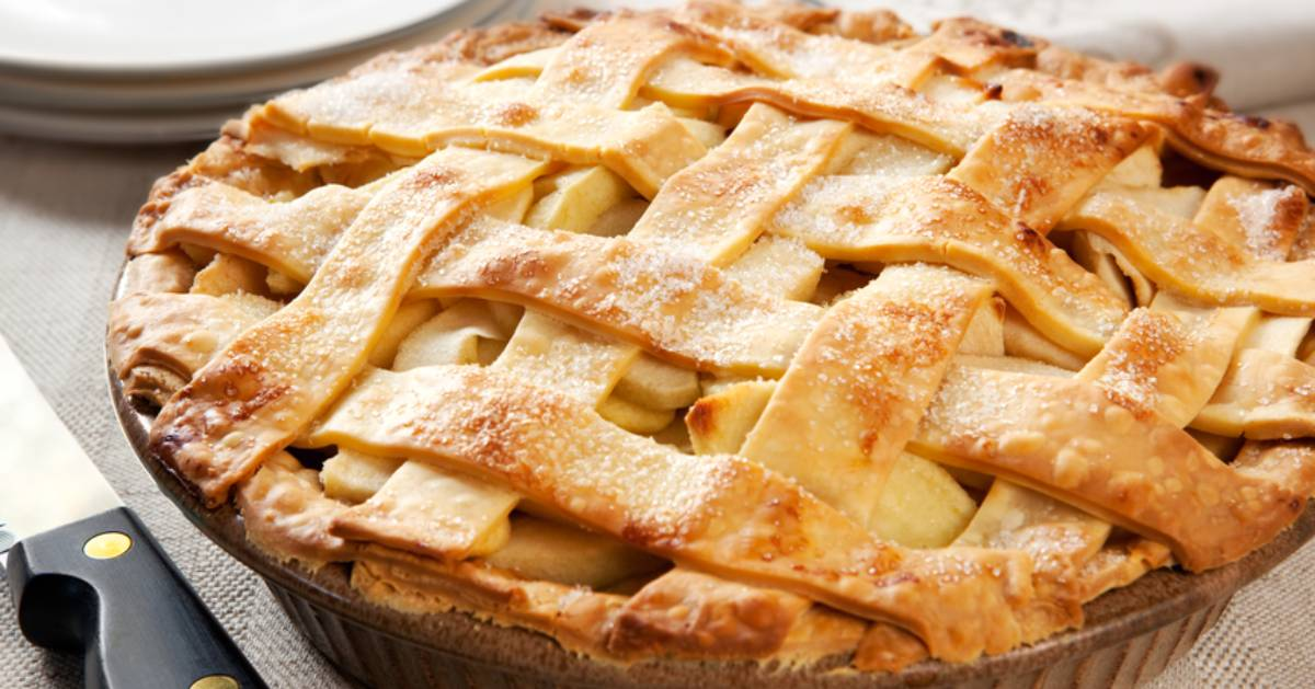 an apple pie with pretty crust