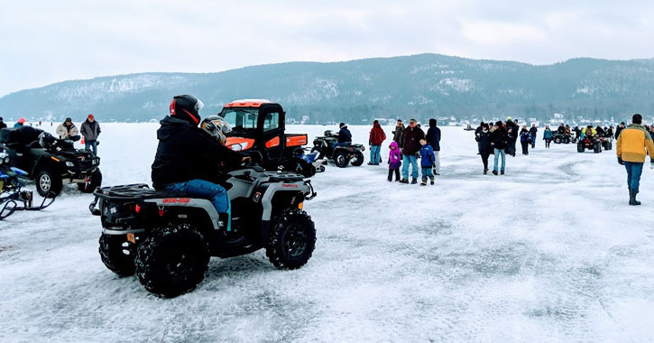 an ATV and people on the ice