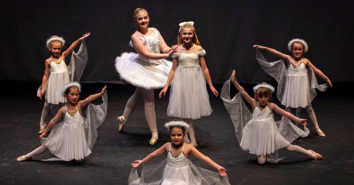 young ballerinas posing on stage