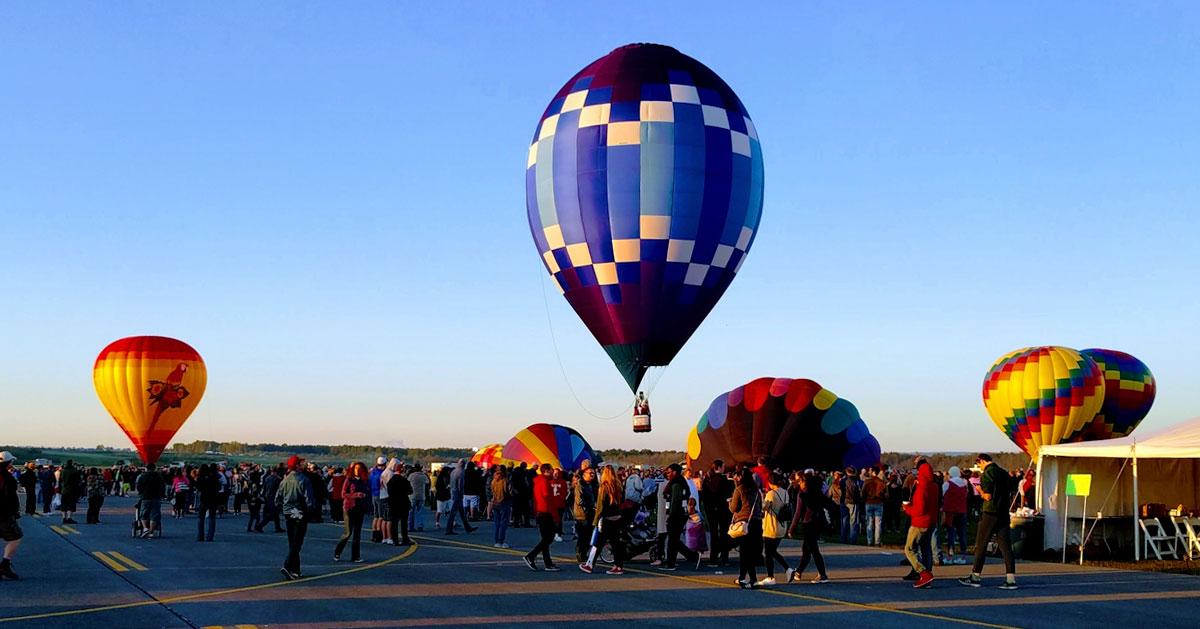 people at a balloon festival