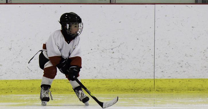 boy in hockey gear on ice