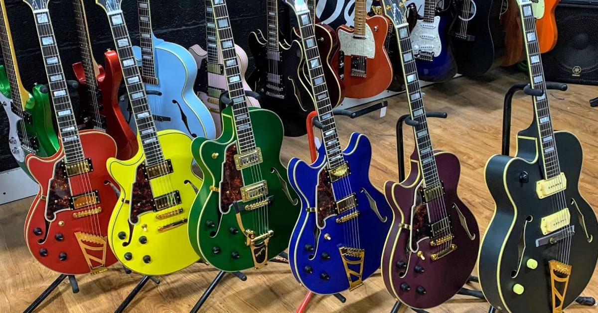 a lineup of colorful guitars