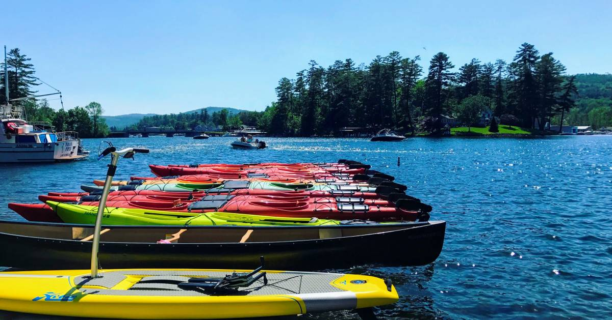 colorful kayaks in the water lined up