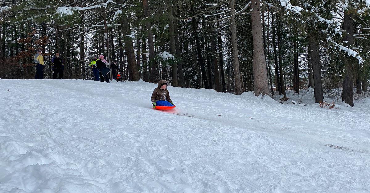 people sledding at crandall park