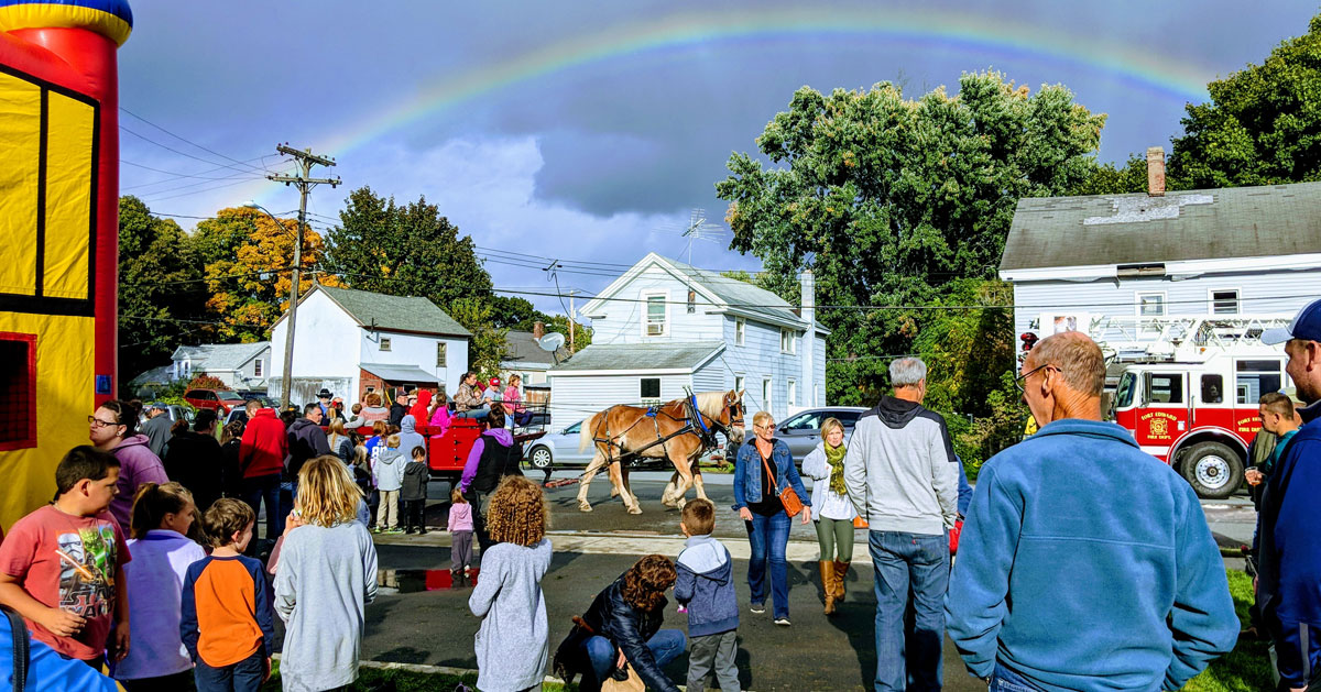 event crowd with a horse and rainbow