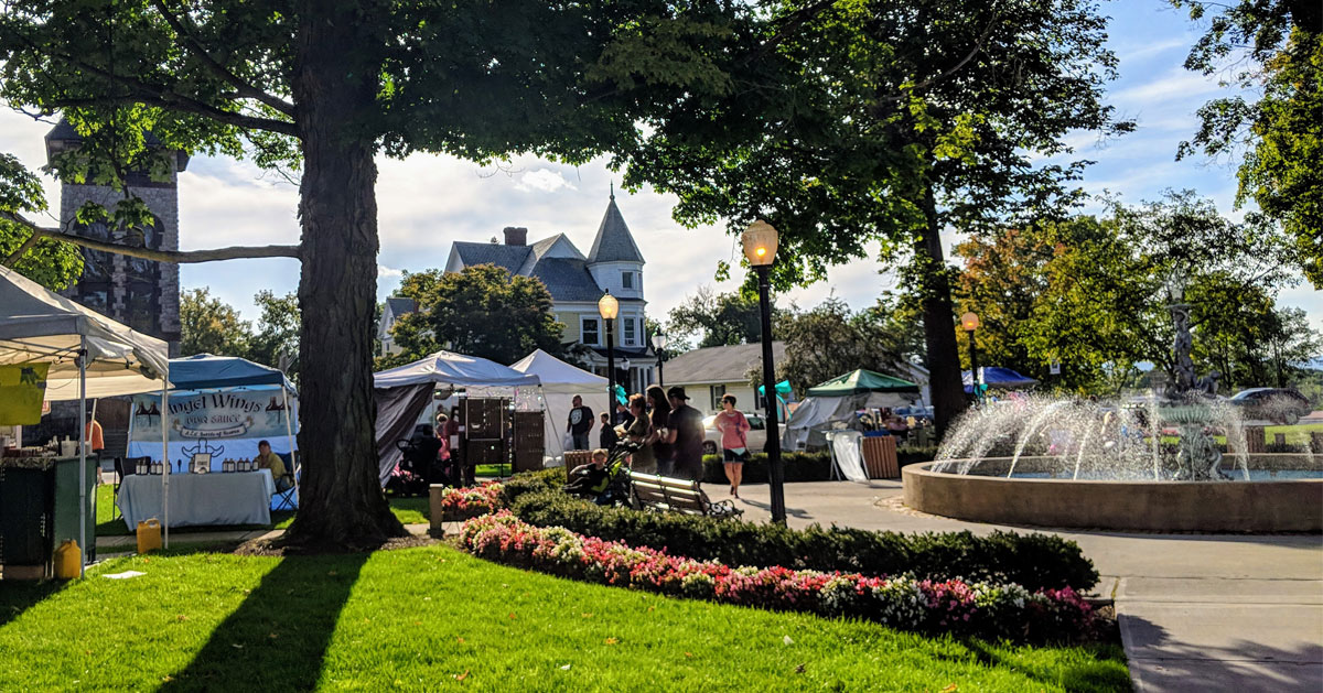 vendors set up in town square by fountain