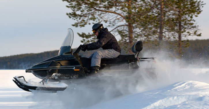 snowmobiler moving fast