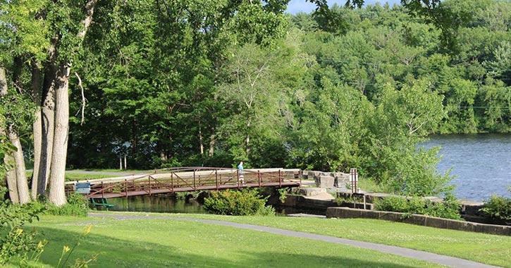 bridge over canal near grassy area