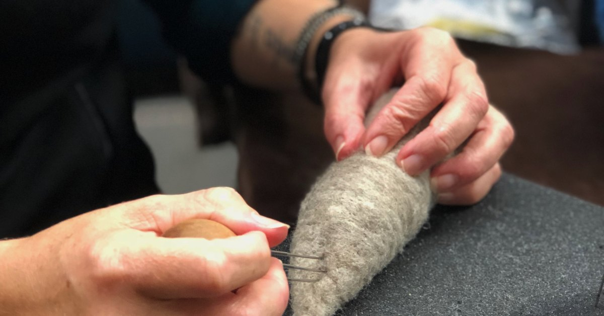 an artisan working with fiber