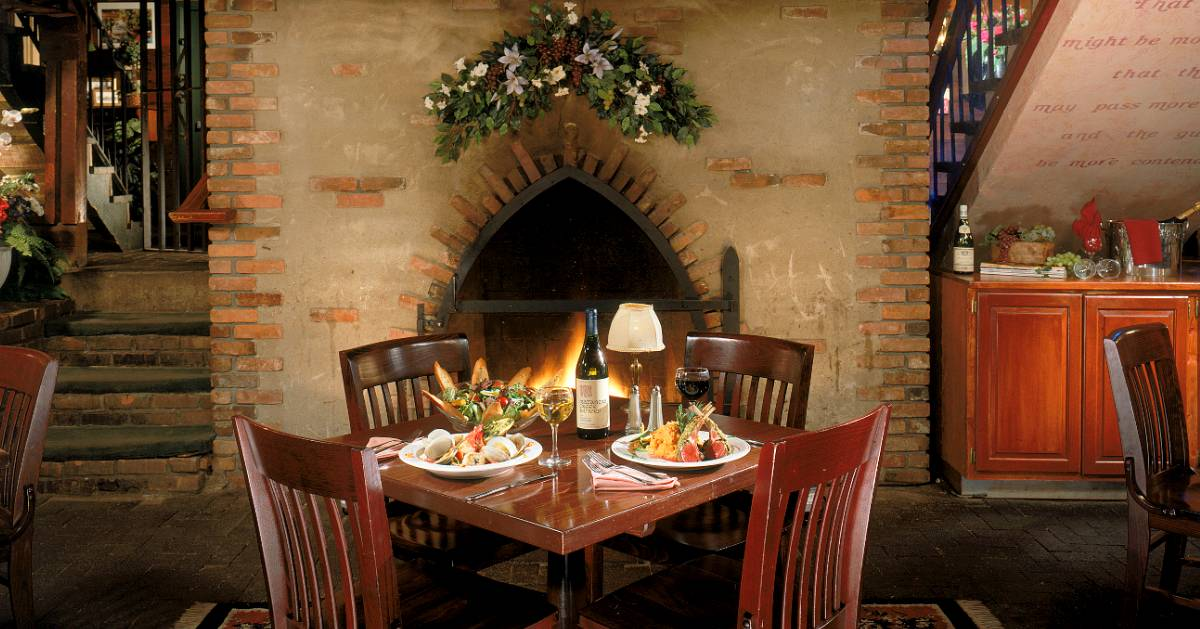 table with dinner by fire in fireplace