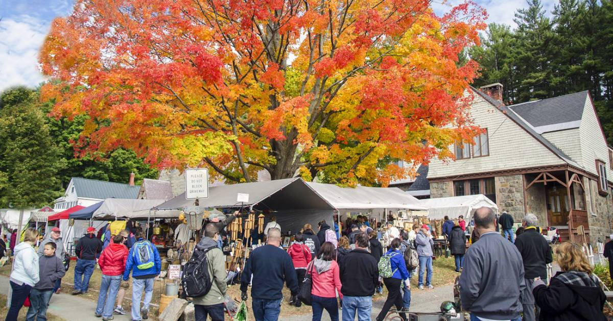 garage sale event with tree with fall foliage