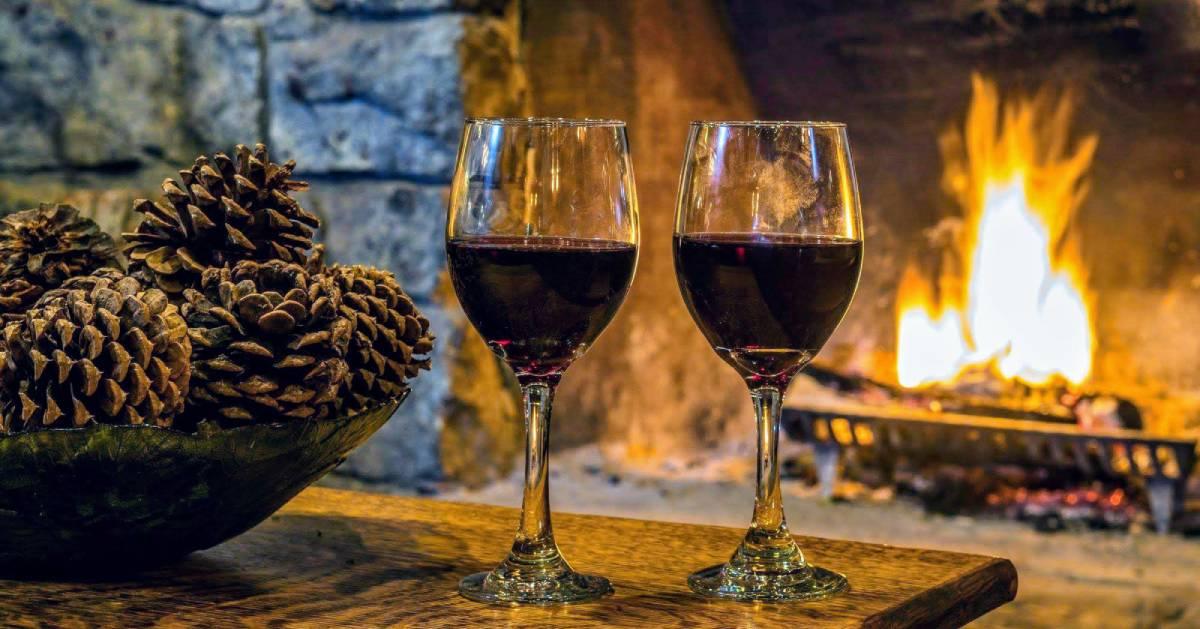 wine glasses in front of fire