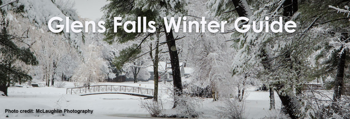a snowy landscape with a small bridge, text saying Glens Falls Winter Guide