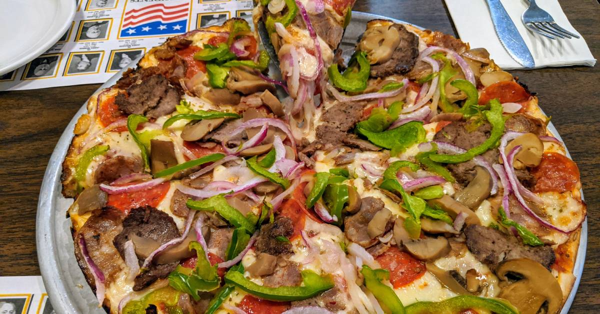 pizza with peppers, onions, mushrooms, etc.