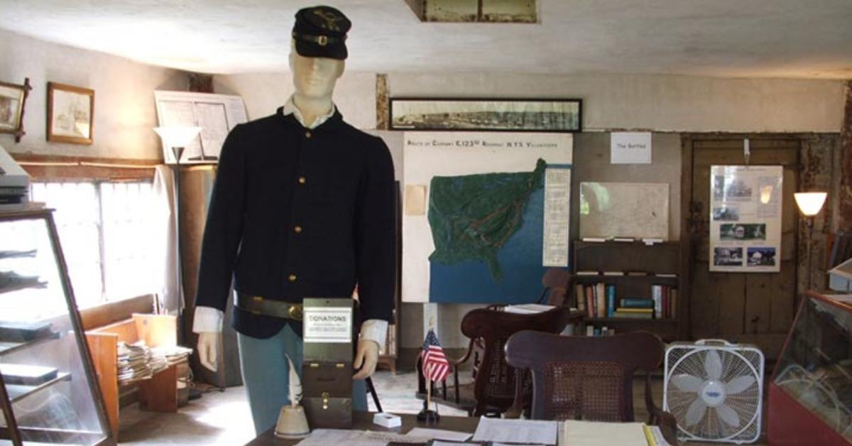 civil war clothing and memorabilia on display in a room