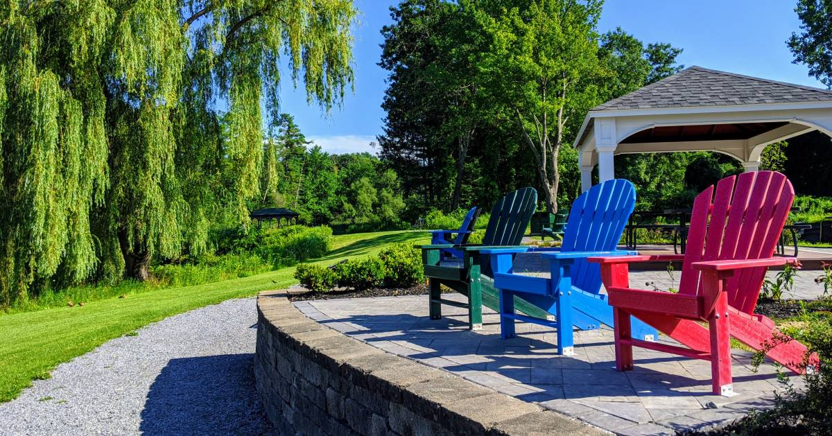 colored Adirondack chairs in park