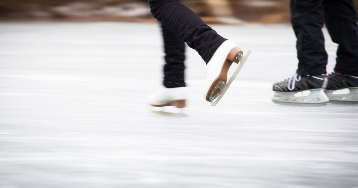 close of couple ice skating