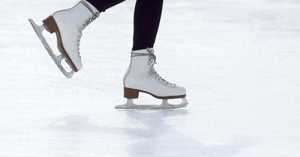 close up of ice skates on the ice