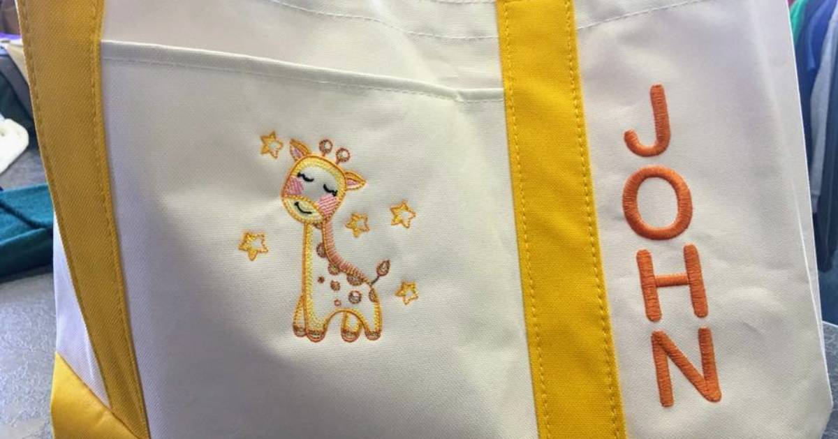 personalized baby bag with a giraffe and the name John