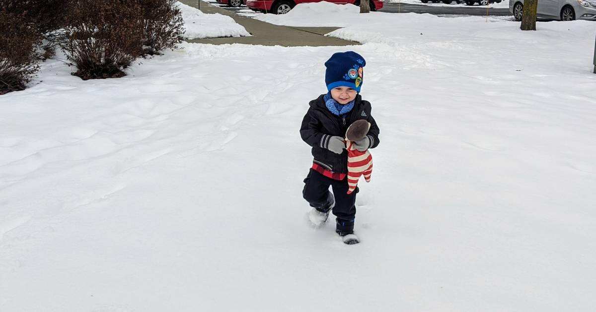 toddler walking in the snow