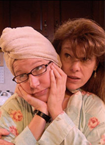 woman in glasses with hair wrapped in towel hugged from behind by another woman