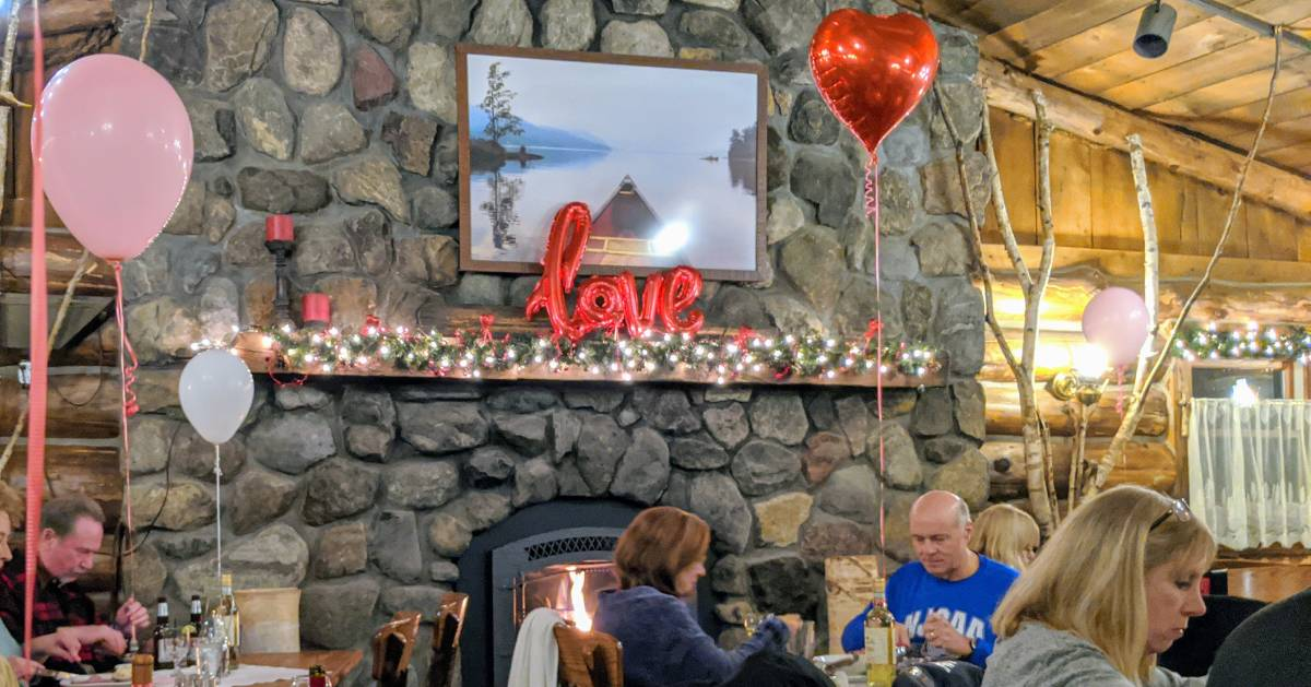 people dining in restaurant set up for Valentine's Day