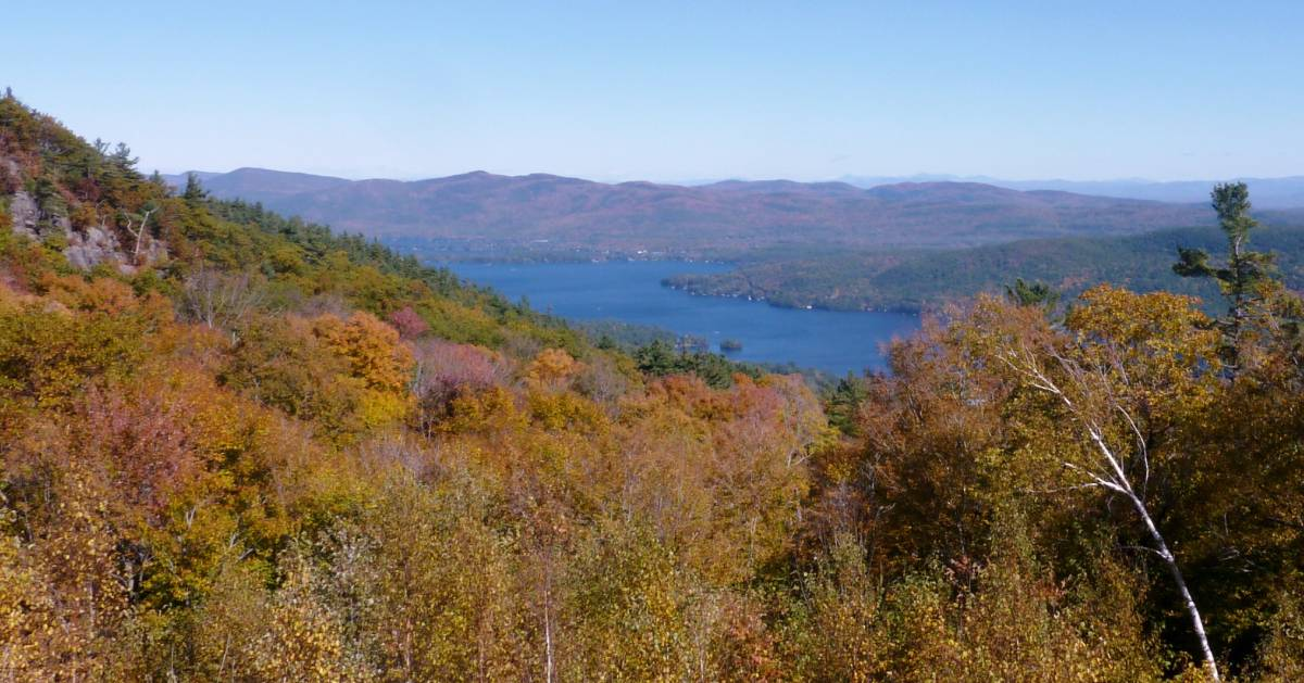 view of foliage and lake from summit