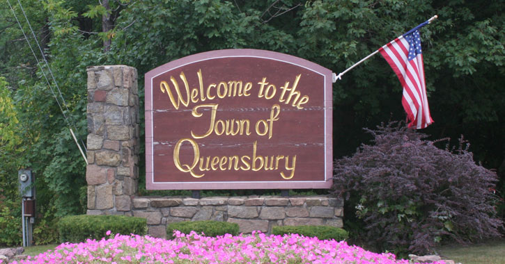 "sign that says ""welcome to the town of queensbury"""