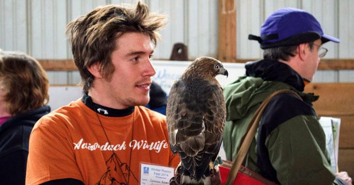 a guy holding a raptor