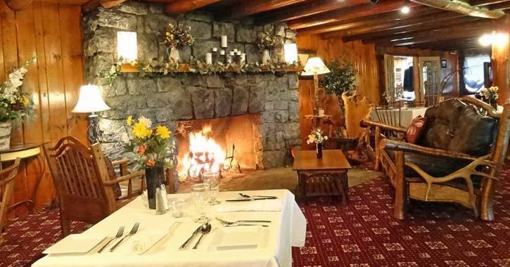a blazing fireplace inside a lounge