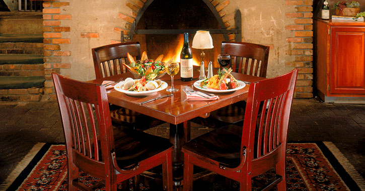 red table with food on top near a fireplace