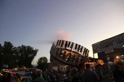 Carnival rides at sunset