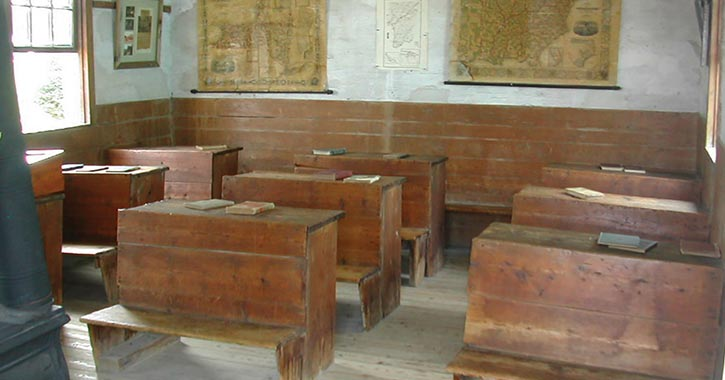 wooden desks in old one room schoolhouse
