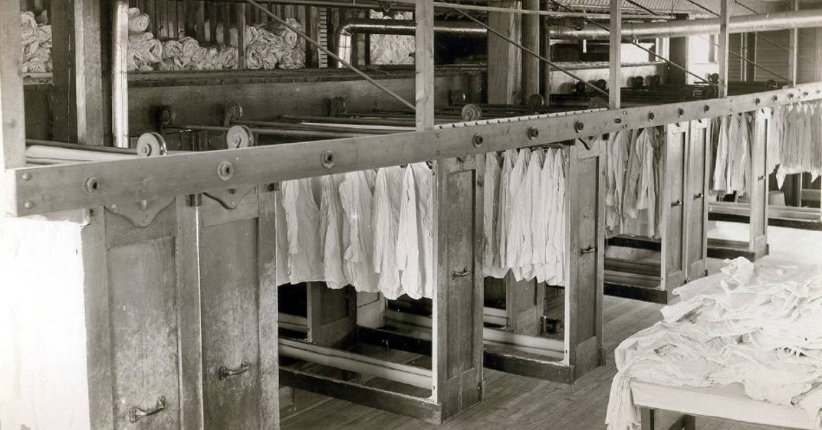 black and white photo of shirts in a factory
