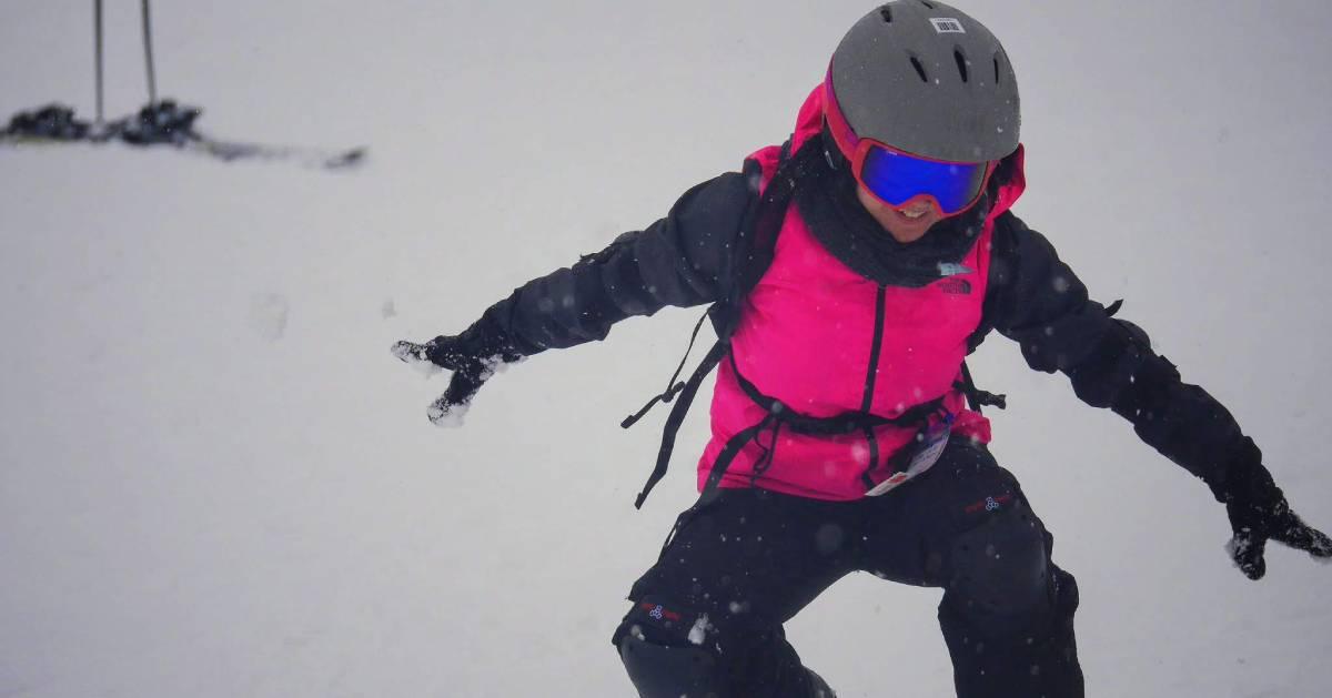 kid snowboarder in pink