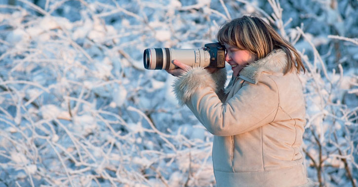 woman taking photo in winter