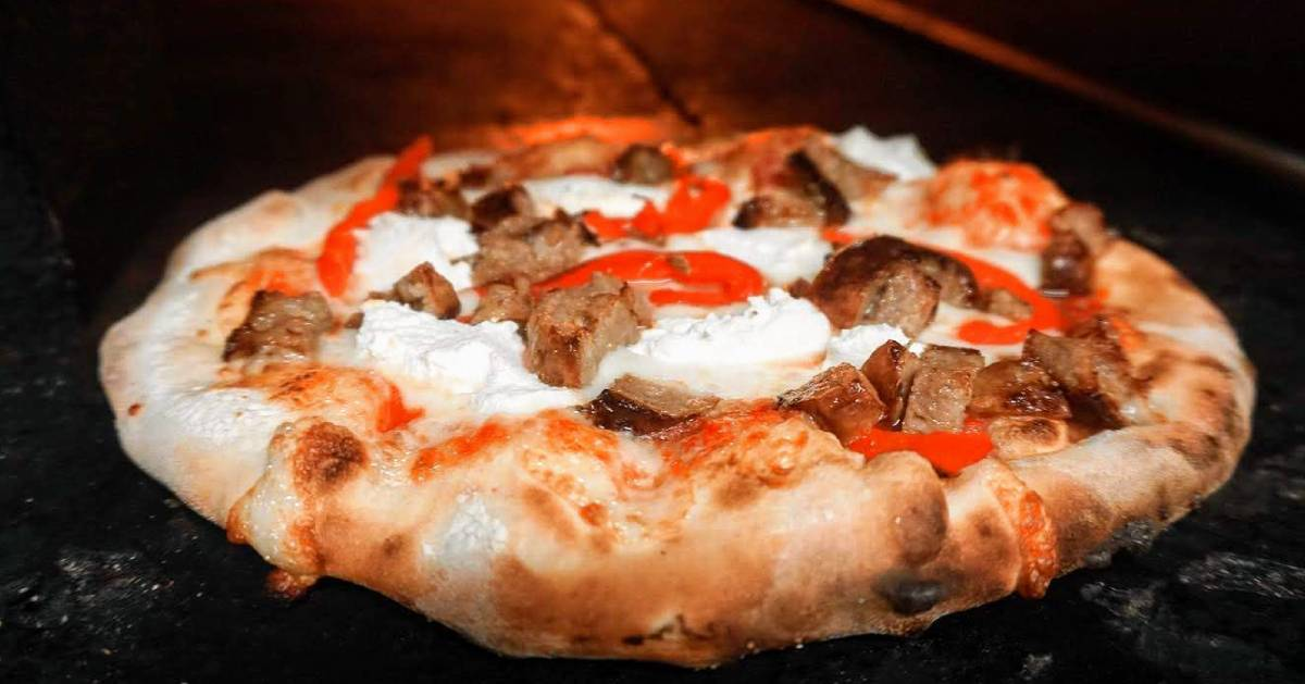 wood fired pizza with sausage, ricotta, and red peppers