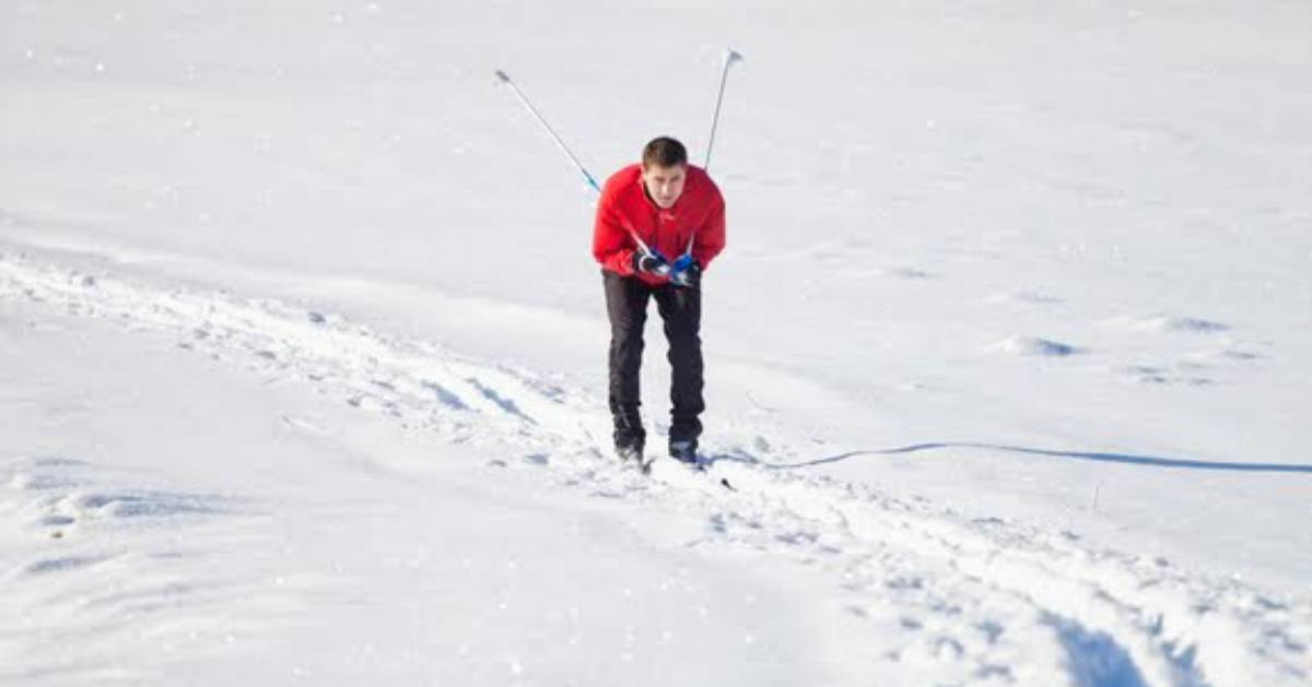guy in red shirt cross-country skiing