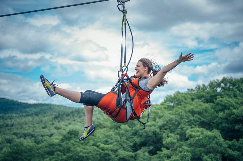 zipliner on the Adirondack Eagle Flyer