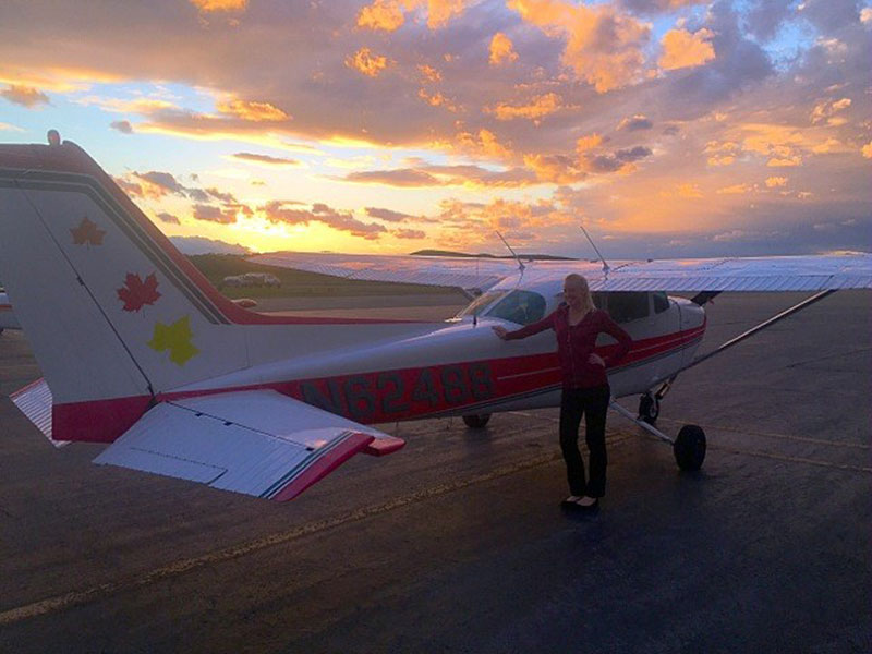 Passenger preparing for sunset flight on a Cessna