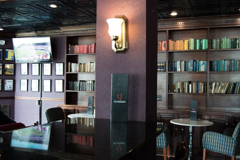 warm pub with bookshelves