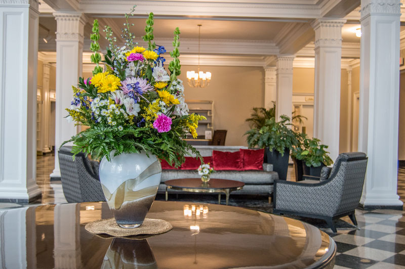 flowers on table in hotel lobby