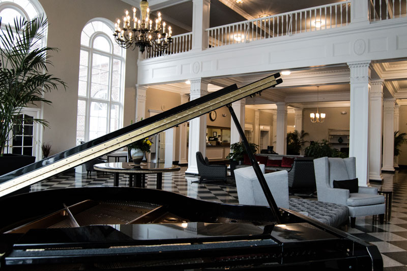 view over baby grand piano into hotel lobby