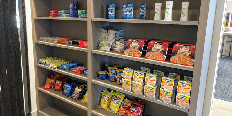shelves filled with snacks like chips and a few toiletries like deodorant