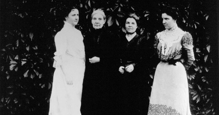 old black and white photo of four women standing next to each other