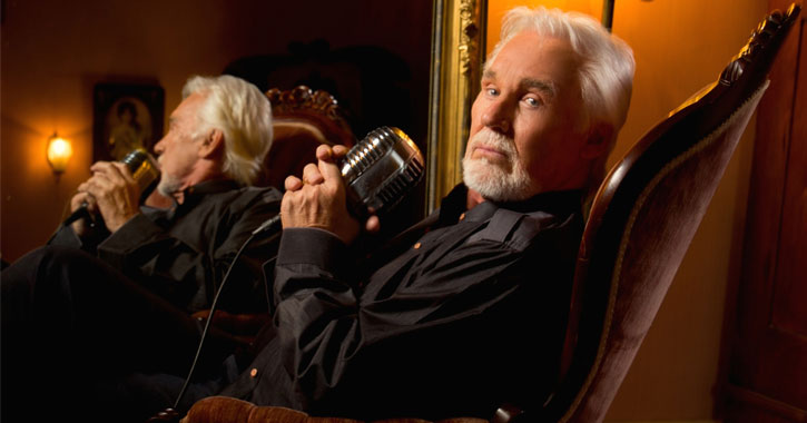 Kenny Rogers looking serious with a microphone